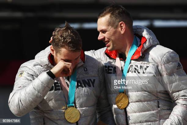 Gold medalists Candy Bauer and Martin Grothkopp of Germany celebrate on the podium during the medal ceremony after the 4man Boblseigh Heats on day...