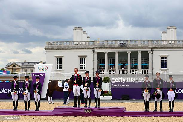 Gold medalists Carl Hester Laura Bechtolsheimer and Charlotte Dujardin of Great Britain silver medalists Dorothee Schneider Kristina Sprehe and Helen...
