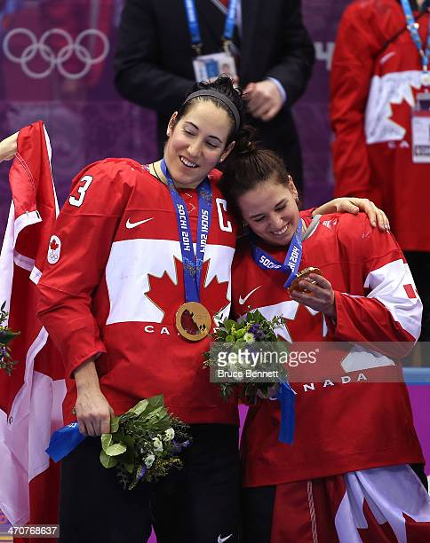 Gold medalists Caroline Oullette and Melodie Daoust of Canada celebrate after defeating the United States 3-2 in overtime during the Ice Hockey...