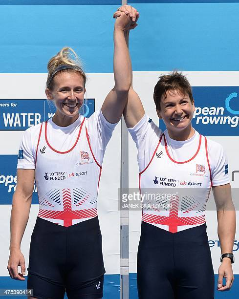 Gold medalists Charlotte Taylor and Katherine Copeland of Great Britain celebrate during the medal ceremony after the Lightweight Women's Double...