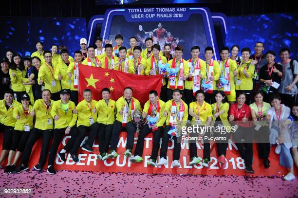 Gold medalists China team celebrate victory on the podium after beating Japan during the Thomas Cup Final match on day eight of the BWF Thomas Uber...