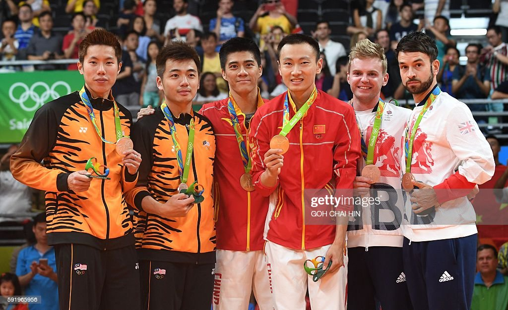 Gold medalists China's Zhang Nan and China's Fu Haifeng (C), Silver medalists Malaysia's V Shem Goh and Malaysia's Wee Kiong Tan, (L) and Bronze medalists Great Britain's Marcus Ellis and Great Britain's Chris Langridge stand with their medals on the podium following the men's doubles Gold Medal badminton match at the Riocentro stadium in Rio de Janeiro on August 19, 2016, for the Rio 2016 Olympic Games. / AFP / GOH Chai Hin