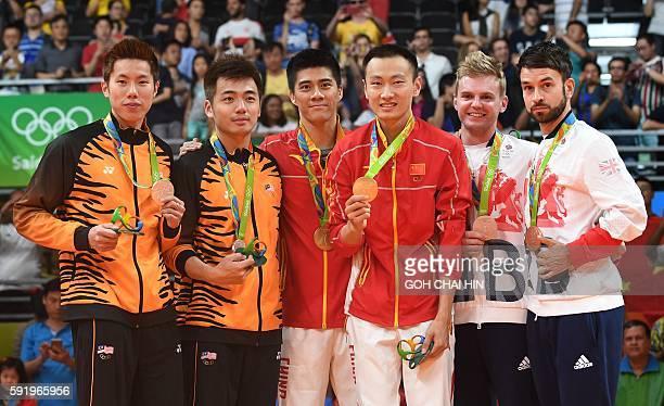 Gold medalists China's Zhang Nan and China's Fu Haifeng Silver medalists Malaysia's V Shem Goh and Malaysia's Wee Kiong Tan and Bronze medalists...