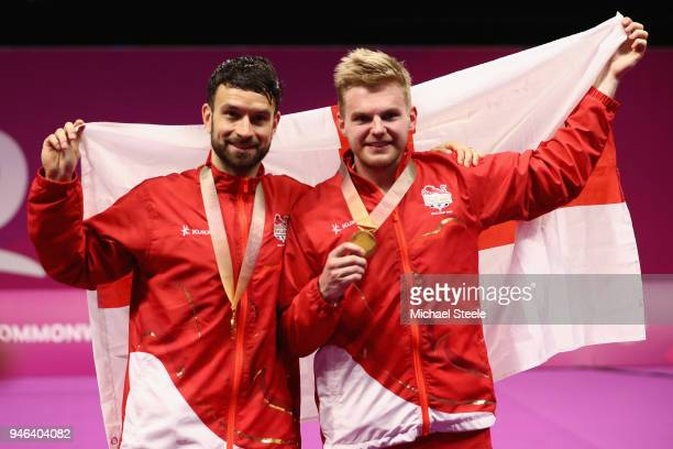 Gold medalists Chris Langridge and Marcus Ellis of England on the winners podium following the men's doubles final match against Chirag...