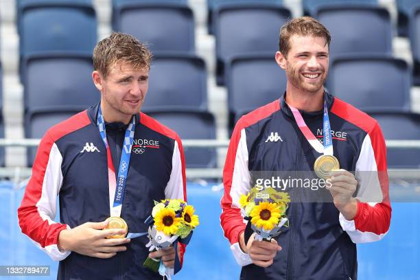 Gold medalists Christian Sandlie Sorum and Anders Berntsen Mol of Team Norway pose during the medal ceremony for the Men's Beach Volleyball on day...