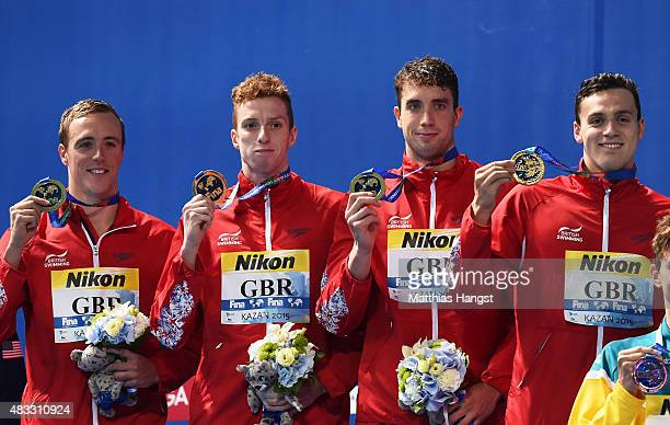 Gold medalists Daniel Wallace Robert Renwick Calum Jarvis and James Guy of Great Britain pose during the medal ceremony for the Men's 4x200m...
