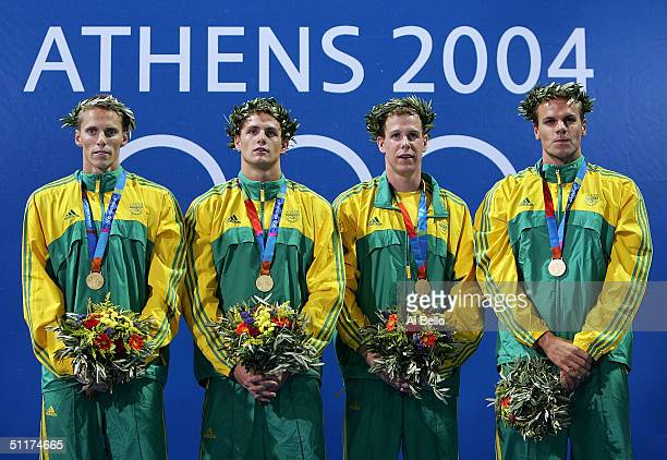 Gold medalists Darian Townsend Lyndon Ferns Mark Roland Schoeman and Ryk Neethling of South Africa stand on the podium during the men's swimming 4 x...