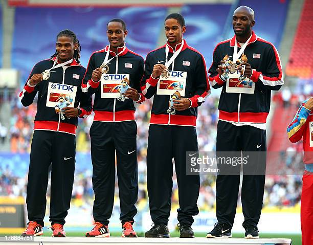 Gold medalists David Verburg Tony McQuay Arman Hall and LaShawn Merritt of the United States pose on the podium during the medal ceremony for the...