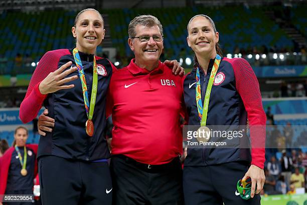 Gold medalists Diana Taurasi head coach Geno Auriemma and Sue Bird of United States celebrate during the medal ceremony after the Women's Basketball...