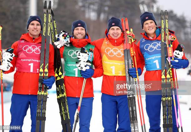 Gold medalists Didrik Toenseth Martin Johnsrud Sundby Simen Hegstad Krueger and Johannes Hoesflot Klaebo of Norway celebrate during the victory...