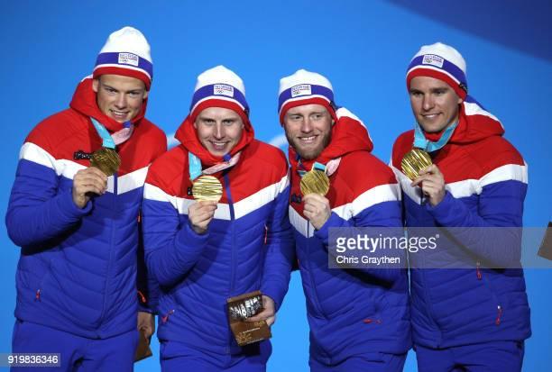 Gold medalists Didrik Toenseth Martin Johnsrud Sundby Simen Hegstad Krueger and Johannes Hoesflot Klaebo of Norway celebrate during the medal...