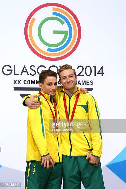 Gold medalists Domonic Bedggood and Matthew Mitcham of Australia celebrate during the medal ceremony in the Men's Synchronised 10m Platform Final at...