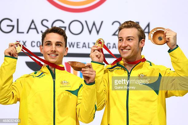 Gold medalists Domonic Bedggood and Matthew Mitcham of Australia pose during the medal ceremony in the Men's Synchronised 10m Platform Final at Royal...