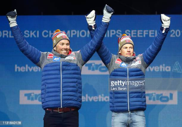 Gold medalists Emil Iversen and Johannes Hoesflot Klaebo of Norway celebrate during the medal ceremony for the Mens' Cross Country Team Sprintof the...