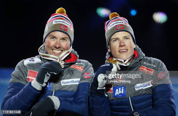 Gold medalists Emil Iversen and Johannes Hoesflot Klaebo of Norway pose with the medals during the medal ceremony for the Mens' Cross Country Team...