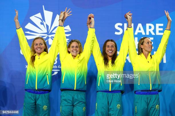 Gold medalists Emma McKeon Brianna Throssell Leah Neale and Ariarne Titmus of Australia pose during the medal ceremony for Women's 4 x 200m Freestyle...
