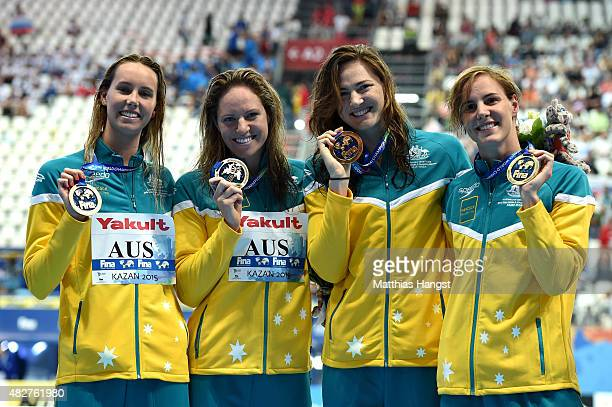 Gold medalists Emma Mckeon Emily Seebohm Cate Campbell and Bronte Campbell of Australia pose during the medal ceremony for the Women's 4x100m...
