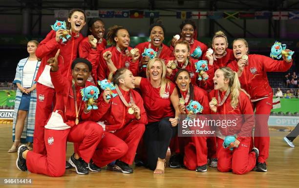 Gold medalists England and head coach Tracey Neville pose during the medal ceremony for the Netball Gold Medal Match on day 11 of the Gold Coast 2018...