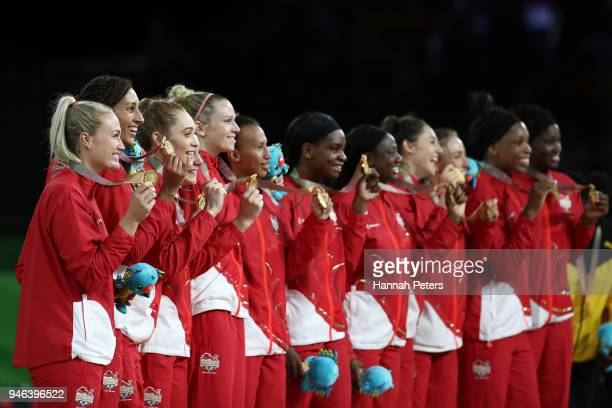 Gold medalists England pose during the medal ceremony for the Netball Gold Medal Match on day 11 of the Gold Coast 2018 Commonwealth Games at Coomera...