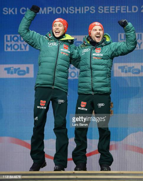 Gold medalists Eric Frenzel and Fabian Riessle of Germany celebrate during the medal ceremony for the Team Sprint Large Hill / 2 X 75km of the Nordic...