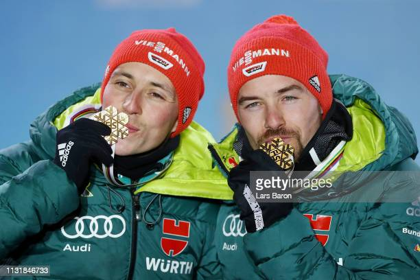 Gold medalists Eric Frenzel and Fabian Riessle of Germany pose with the medals during the medal ceremony for the Team Sprint Large Hill / 2 X 75km of...