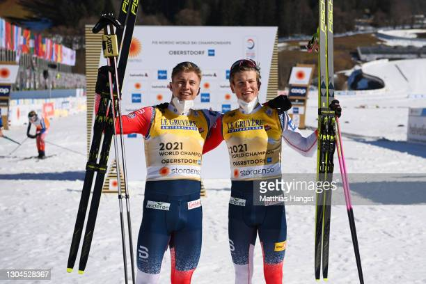Gold medalists Erik Valnes and Johannes Hoesflot Klaebo of Norway celebrate following their victory in the Men's Cross Country Team Sprint Finals at...