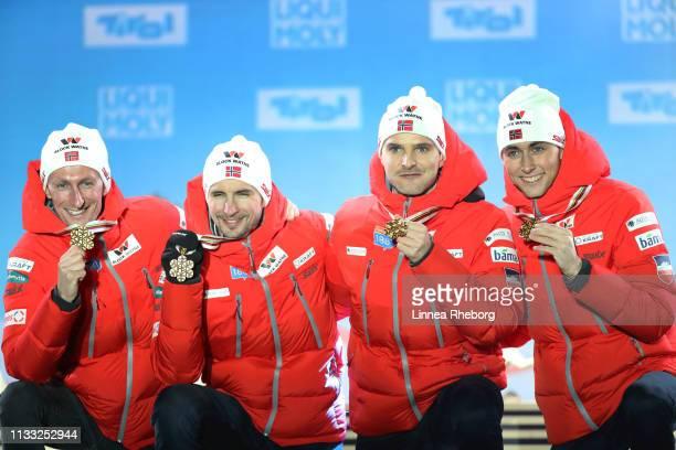 Gold medalists Espen Bjoernstad of Norway Jan Schmid of Norway Joergen Graabak of Norway and Jarl Magnus Riiber of Norway celebrate during the Medal...