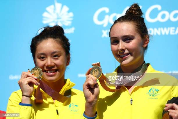 Gold medalists Esther Qin and Georgia Sheehan of Australia pose during the medal ceremony for the Women's Synchronised 3m Springboard Diving Final on...
