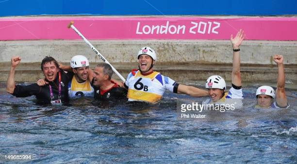 Gold medalists Etienne Stott and Tim Baillie of Great Britain celebrate with silver medalists David Florence and Richard Hounslow of Great Britain...