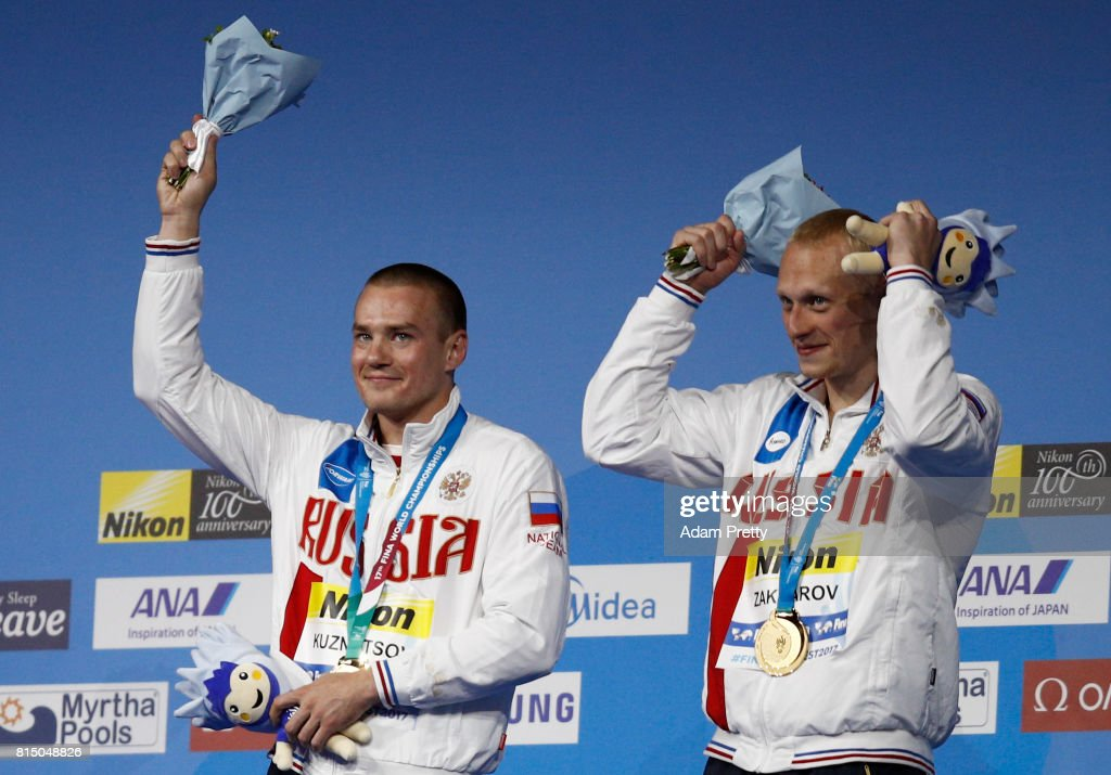 Gold medalists Evgenii Kuznetsov and Ilia Zakharov of Russia pose with their medals following victory in the Men's Diving 3m Sychro Springboard Final on day two of the Budapest 2017 FINA World Championships on July 15, 2017 in Budapest, Hungary.