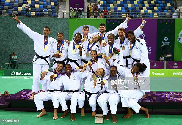 Gold medalists France pose with the medals won in the Men's and Women's Team finals during day sixteen of the Baku 2015 European Games at Heydar...