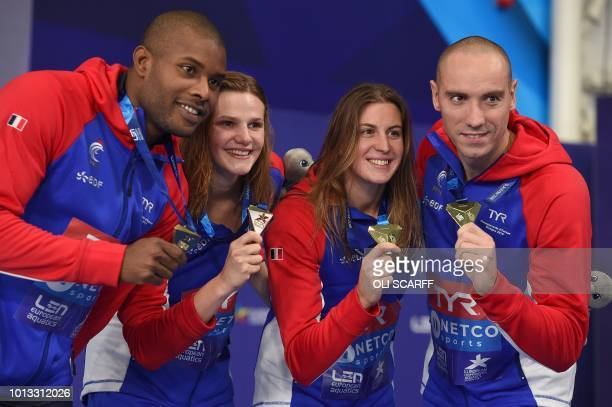 Gold medalists France's Jeremy Stravius, France's Mehdy Metella, France's Marie Wattel and France's Charlotte Bonnet pose on the podium during the...