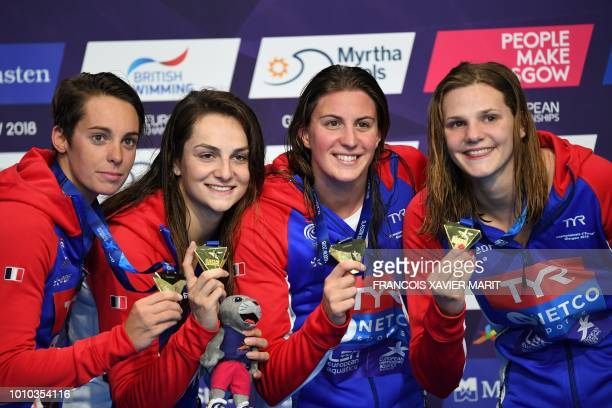 Gold medalists France's Marie Wattel, France's Margaux Fabre, France's Charlotte Bonnet and France's Beryl Gastaldello pose on the podium during the...