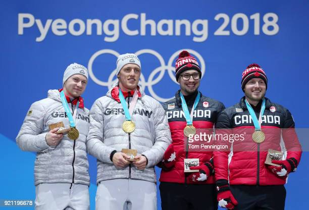 Gold medalists Francesco Friedrich and Thorsten Margis of Germany and gold medalists Alexander Kopacz and Justin Kripps of Canada celebrate during...
