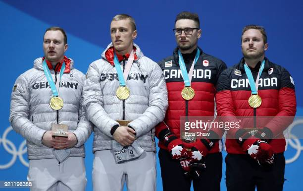 Gold medalists Francesco Friedrich and Thorsten Margis of Germany and gold medalists Alexander Kopacz and Justin Kripps of Canada stand on the podium...