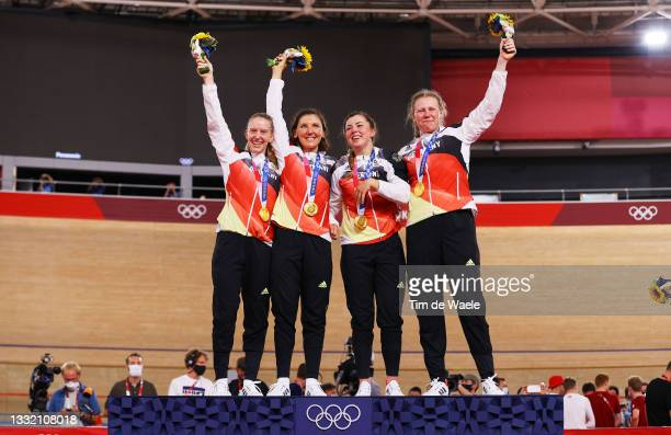 Gold medalists Franziska Brausse, Lisa Brennauer, Lisa Klein and Mieke Kroeger of Team Germany, pose on the podium during the medal ceremony after...