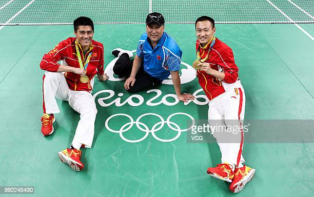 Gold medalists Fu Haifeng and Zhang Nan of China pose with their head coach Li Yongbo after the medal ceremony for the Men's Badminton Doubles final...
