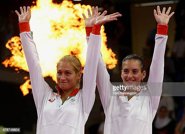 Gold medalists Gabriela Stoeva and Stefani Stoeva of Bulgaria stand on the podiumd during the medal ceremony for the Women's Badminton Doubles on day...