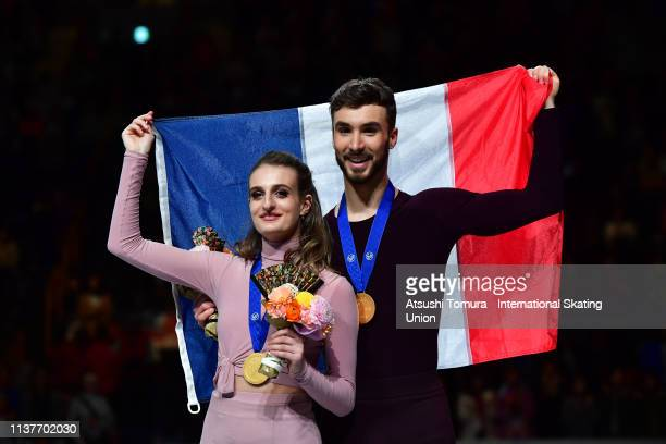 Gold medalists Gabriella Papadakis and Guillaume Cizeron of France pose for photographs after the medal ceremony for the Ice Dance on day four of the...