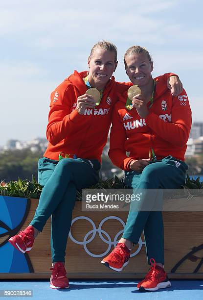 Gold medalists Gabriella Szabo and Danuta Kozak of Hungary celebrate on the podium after competing during the Women's Kayak Double 500m Final A on...