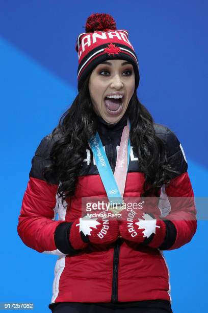 Gold medalists Gabrielle Daleman of Team Canada celebrates during the medal ceremony after the Figure Skating Team Event at Medal Plaza on February...