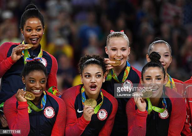 Gold Medalists Gabrielle Douglas Simone Biles Lauren Hernandez Madison Kocian and Alexandra Raisman of the United States pose for photographs on the...