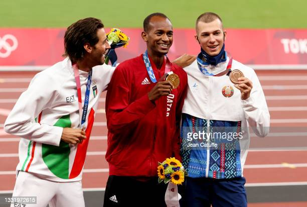 Gold Medalists Gianmarco Tamberi of Italy and Mutaz Essa Barshim of Qatar, Bronze Medalist Maksim Nedasekau of Belarus during the medal ceremony of...