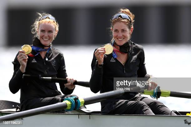 Gold medalists Grace Prendergast and Kerri Gowler of Team New Zealand pose with their medals in their boat after the Women's Pair Final A on day six...