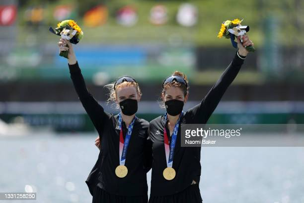 Gold medalists Grace Prendergast and Kerri Gowler of Team New Zealand pose with their medals during the medal ceremony for the Women's Pair Final A...