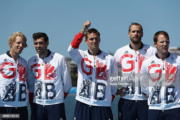 Gold medalists Great Britain celebrate on the podium at the medal ceremony for the Men's Eight on Day 8 of the Rio 2016 Olympic Games at the Lagoa...
