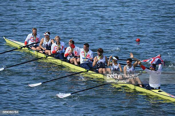 Gold medalists Great Britain celebrate on their boat after the medal ceremony for the Men's Eight on Day 8 of the Rio 2016 Olympic Games at the Lagoa...