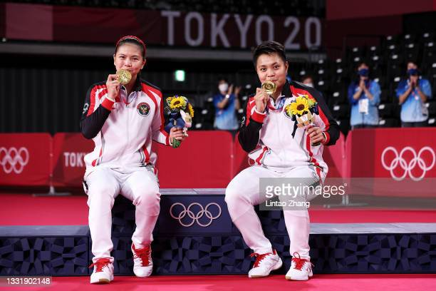 Gold medalists Greysia Polii and Apriyani Rahayu of Team Indonesia pose on the podium during the medal ceremony for the Women's Doubles badminton...