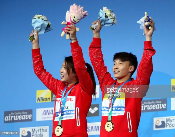 BUDAPEST HUNGARY JULY Gold medalists Han Wang and Zheng Li of China pose with the medals won during the Mixed 3M Synchro Springboard final on day...