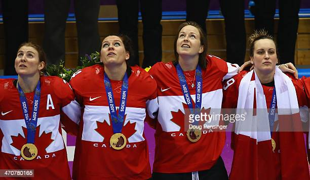 Gold medalists Hayley Wickenheiser Natalie Spooner Tara Watchorn and MariePhilip Poulin of Canada celebrate during the flower ceremony for the Ice...